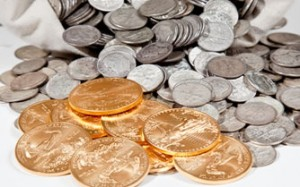 Silver-coins-in-bag-and-Gold-Eagle-bullion-coins-300x187