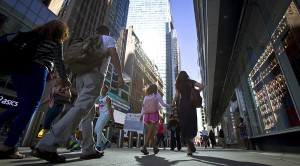 A woman and child walk along 42nd St towards Times Square in the Manhattan borough of New York, August 28, 2015. REUTERS/Carlo Allegri - RTX1Q2OK
