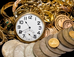 Close-up Pocket watch, coins & jewelry